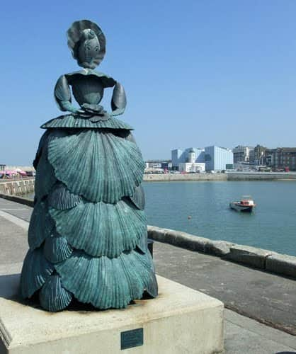 Sophia looks out from Margate Pier towards Boulogne (Shell lady sculpture by Ann Carrington)